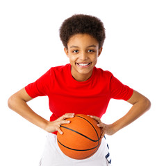 African American teenager with basketbal