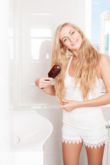 Woman combing in bathroom