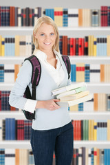 Young College Student Girl In A Library