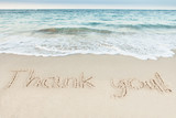 Fototapety Thank You Written On Sand By Sea