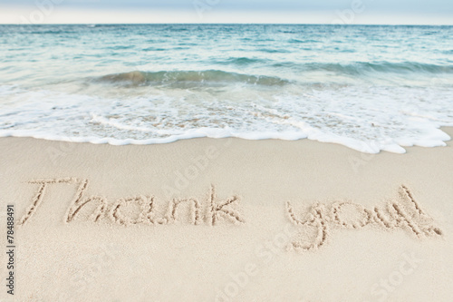 Fotobehang Strand Thank You Written On Sand By Sea