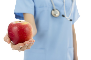 Doctor giving apple