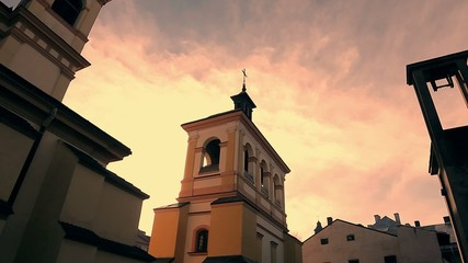 Old church on evening sky background. Moving clouds.