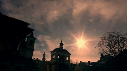 Silhouette of a Christian cathedral on evening sun background.