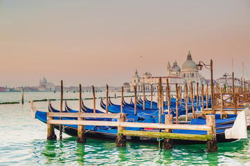Venetian gondolas on the Grand Canal in a romantic light of suns