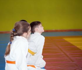 Children sitting on tatami