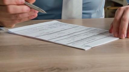 Businessman Filling Tax Form