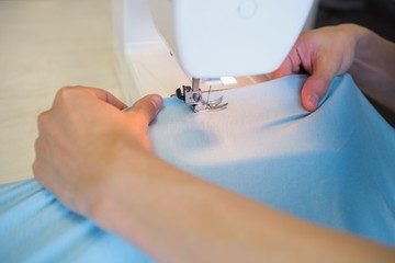 Close up of student using sewing machine