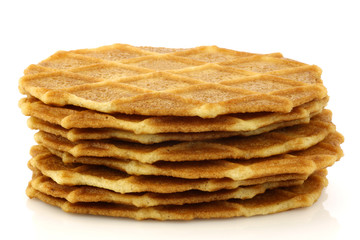freshly baked stacked Dutch waffles on a white background