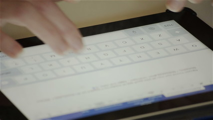 Woman writes a letter to the virtual keyboard