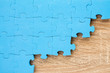 Jigsaw puzzle on wooden background