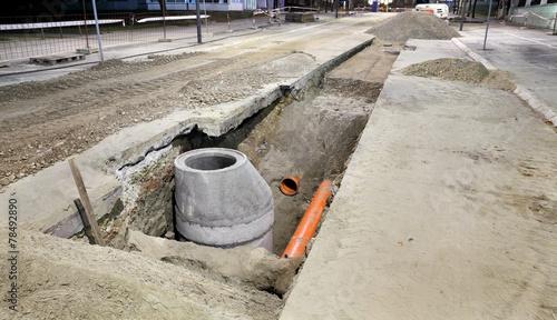 Foto Spatwand Kanaal Hydro construction work, reconstruction of sewerage, night photo