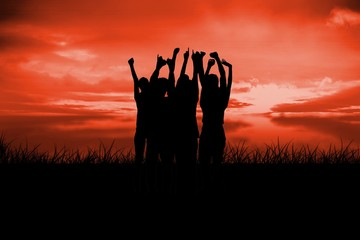 Composite image of silhouette of cheering people