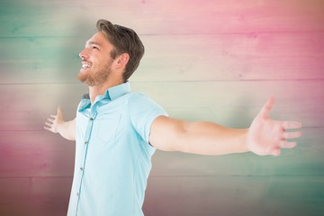 Composite image of handsome young man posing with arms out