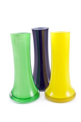 Three colorful glass vases isolated on white