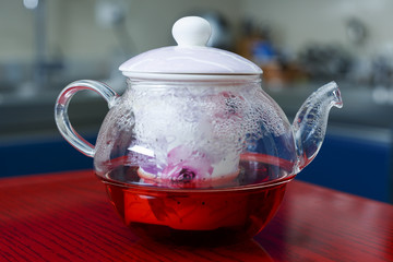 a kettle with tea flowers roses