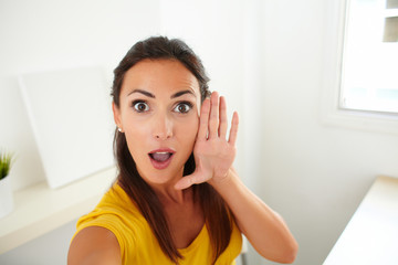 Lovely woman taking a funny selfie with phone