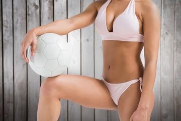 Composite image of fit woman in bikini