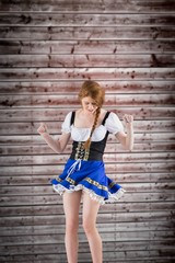 Composite image of oktoberfest girl moving and dancing