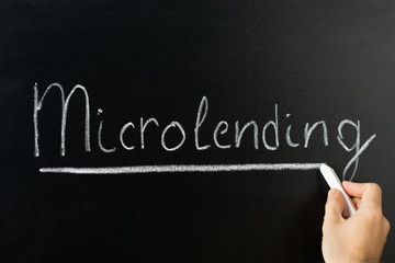 Hand Writing Microlending Text On Blackboard