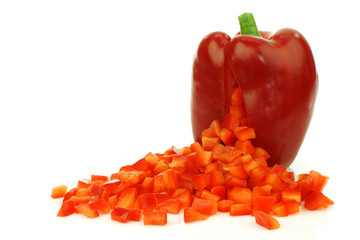 fresh red bell pepper with pieces coming out