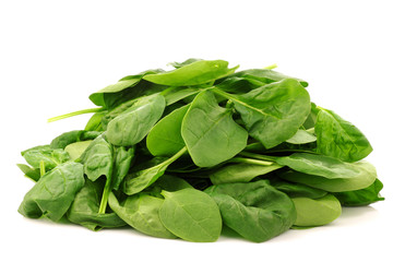 bunch of fresh spinach leaves on a white background