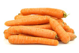 bunch of fresh winter carrots on a white background