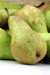 bunch of green fresh pears on a white background
