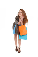 portrait of a beautiful young girl holding shopping bags