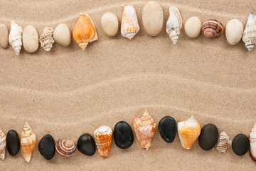 Stripe of sea shells and stones lying on the sand