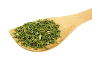 Wood spoon with chopped chives