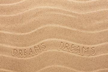 Dream inscription on the wavy sand