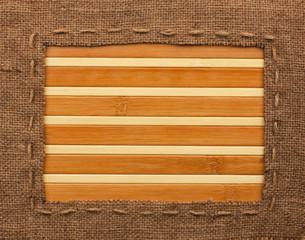 Frame of burlap, lies on a bamboo mat