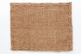 Fototapety Frame of burlap  lies on a white  background
