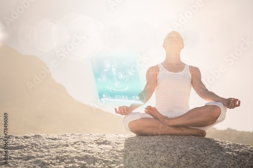 canvas print picture Composite image of blonde woman sitting in lotus pose on beach