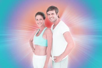 Composite image of fit couple smiling at camera