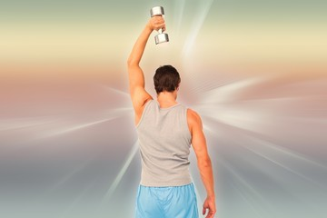 Composite image of rear view of a man exercising with dumbbell
