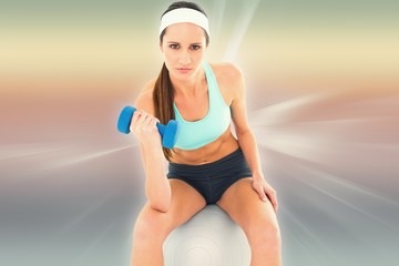 Fit young woman exercising with dumbbell
