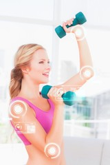 Composite image of toned blonde lifting dumbbells and smiling