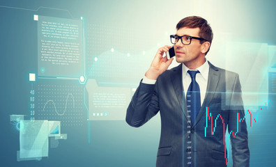 buisnessman with cell phone and forex chart