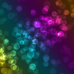 Blurred colourful sparkles defocused background
