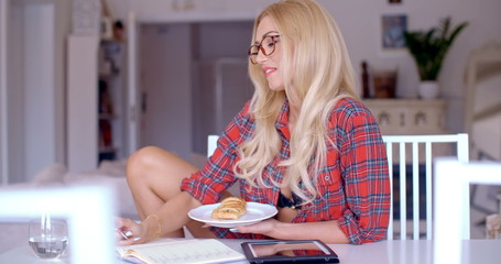 Woman enjoying a snack while working at home