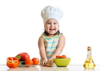 cook kid girl preparing vegetables