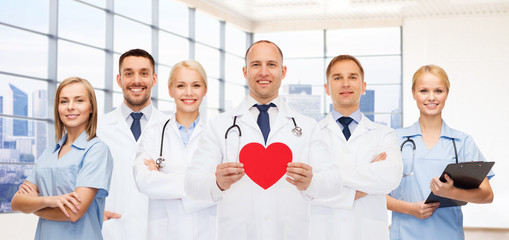happy young doctors cardiologists with red heart