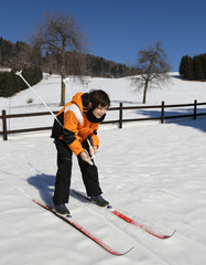 young boy for first time with cross-country skiing