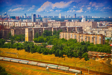 Moscow cityscape, houses, trees, railroad