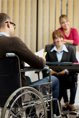 man on wheelchair is doing job interview