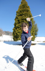 young boy falls with cross-country skis