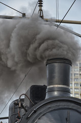 Old train in clouds of smoke