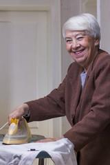 Older woman ironing